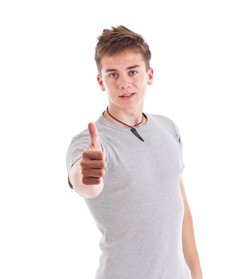 Hombre joven con los pulgares para arriba imagen de archivo libre de regalías