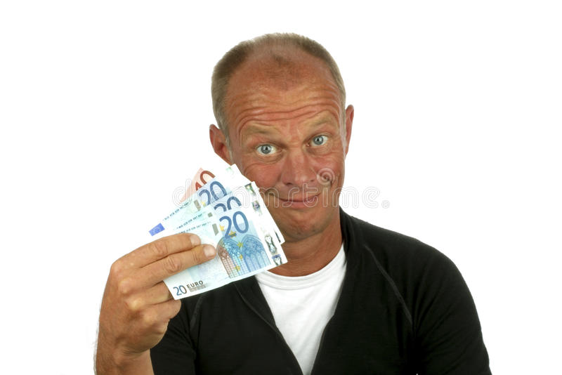 Hombre joven con su dinero fotos de archivo