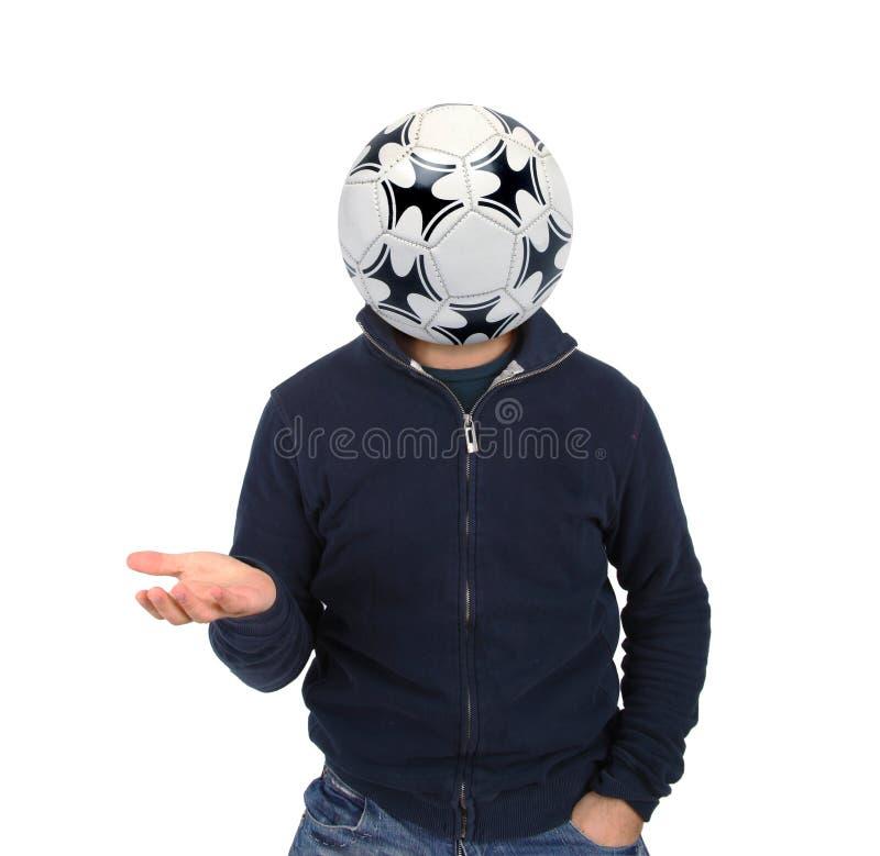Hombre joven con un balón de fútbol en vez de la cabeza fotos de archivo libres de regalías