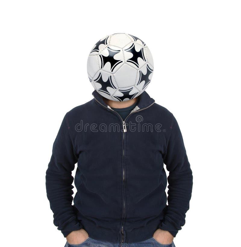 Hombre joven con un balón de fútbol en vez de la cabeza imagenes de archivo