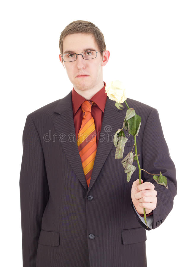 Hombre joven con una rosa foto de archivo libre de regalías