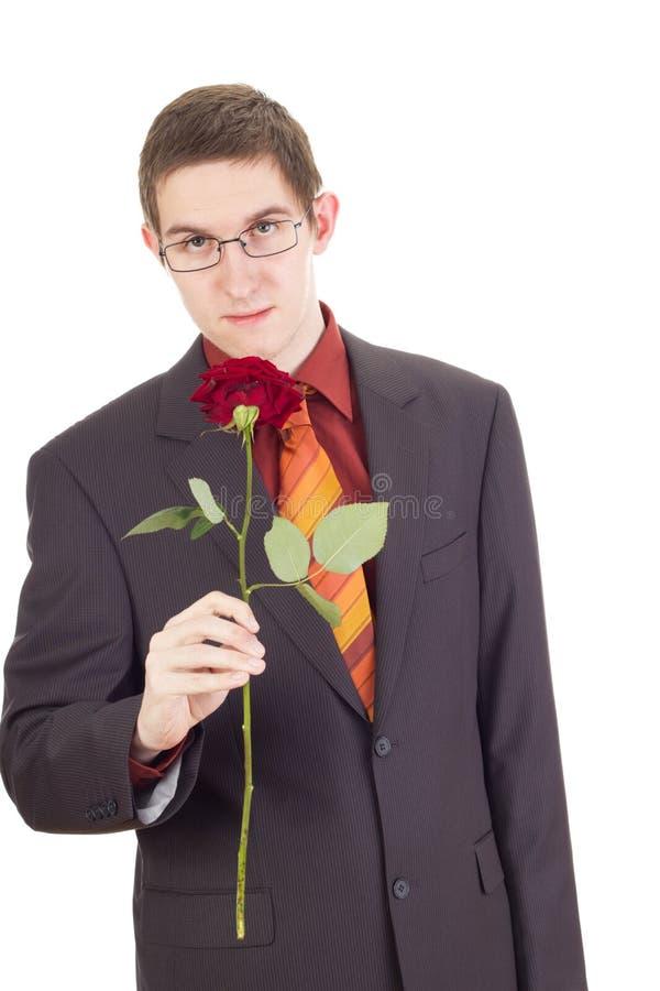 Hombre joven con una rosa fotografía de archivo libre de regalías