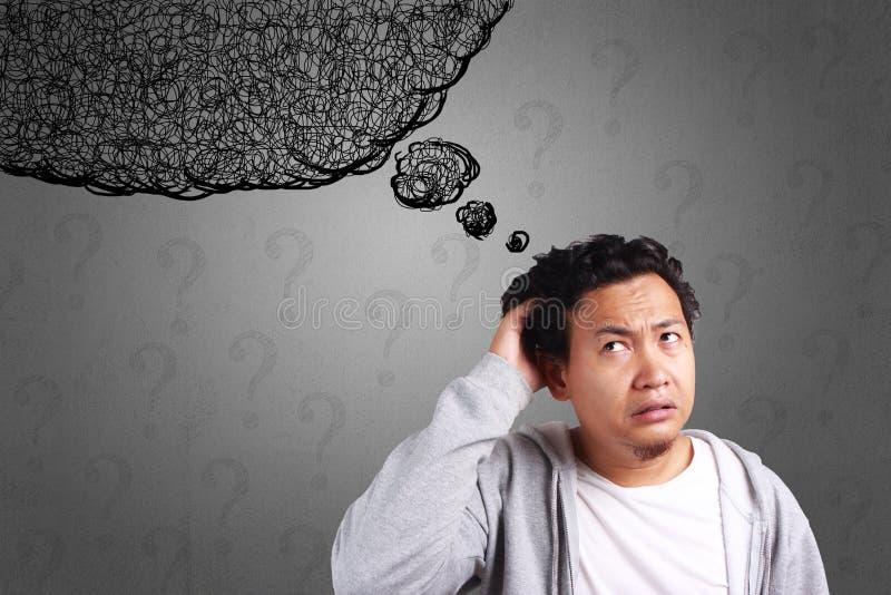 Hombre joven confundido, expresión de la tensión imagen de archivo libre de regalías