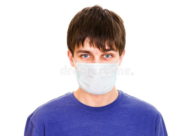 Hombre joven en máscara de la gripe imágenes de archivo libres de regalías
