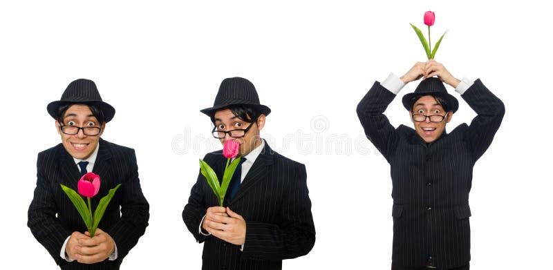 Hombre joven en traje negro con la flor aislada en blanco imagenes de archivo