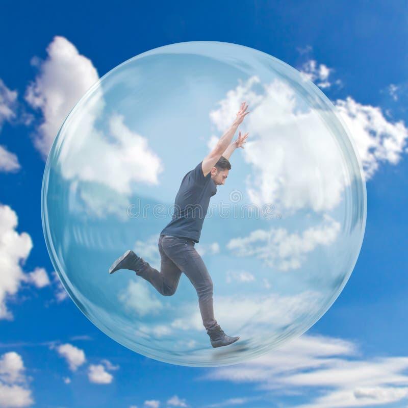 Hombre joven en una burbuja imagen de archivo
