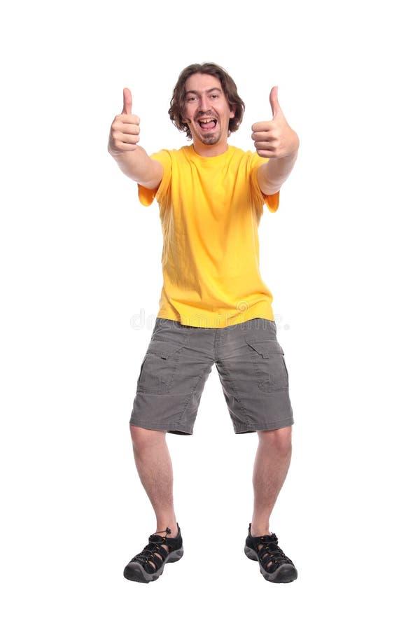 Hombre joven feliz con los pulgares para arriba foto de archivo