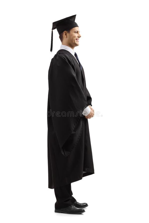 Hombre joven feliz en vestido de la graduación foto de archivo libre de regalías