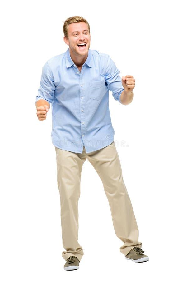 Hombre joven feliz que celebra éxito en el fondo blanco foto de archivo