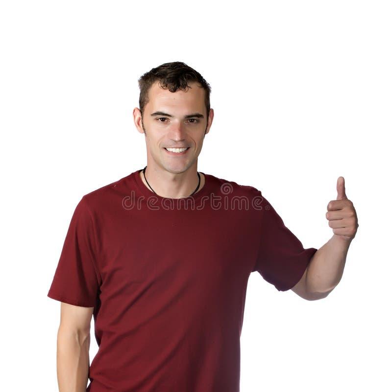 Hombre joven feliz que da los pulgares para arriba imagen de archivo