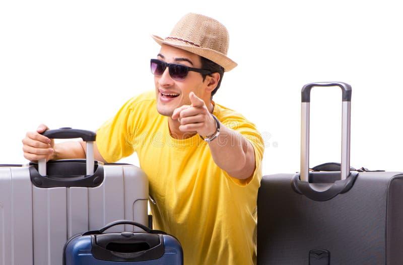 Hombre joven feliz que va el las vacaciones de verano aisladas en blanco imagen de archivo