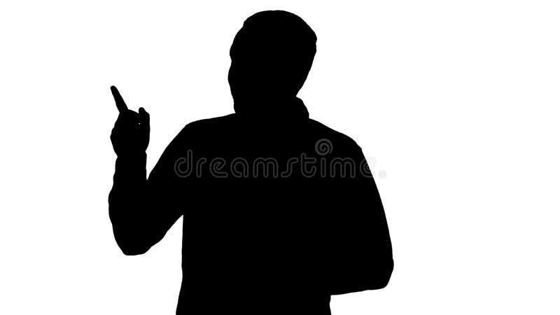 Hombre joven hermoso de la silueta que camina y que mira a la cámara y que señala a los lados que muestran algo libre illustration