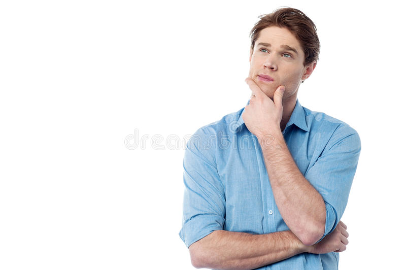 Hombre joven hermoso que piensa algo fotos de archivo libres de regalías