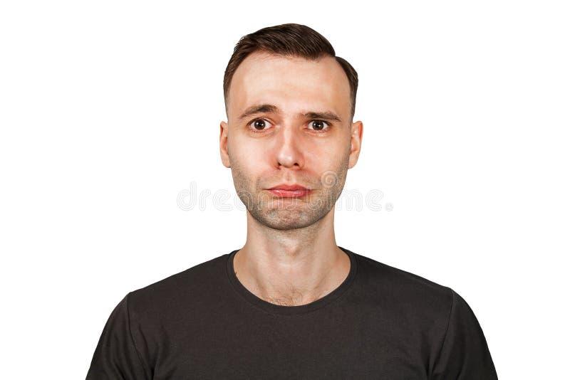 Hombre joven infeliz, triste aislado en el fondo blanco fotos de archivo