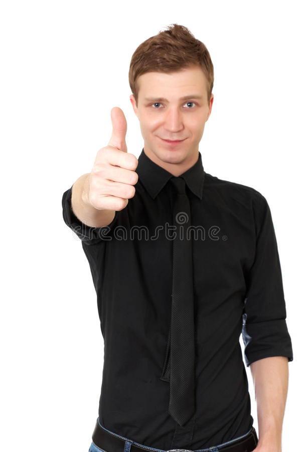 Hombre joven ocasional feliz que muestra el pulgar para arriba imagenes de archivo