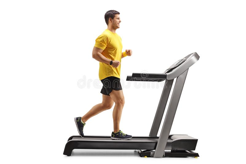 Hombre joven que corre en una rueda de ardilla profesional foto de archivo libre de regalías