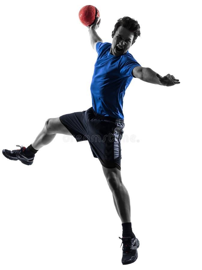 Hombre joven que ejercita la silueta del jugador del balonmano imágenes de archivo libres de regalías