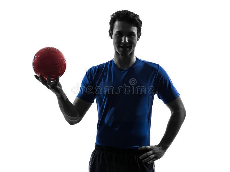 Hombre joven que ejercita la silueta del jugador del balonmano imagen de archivo