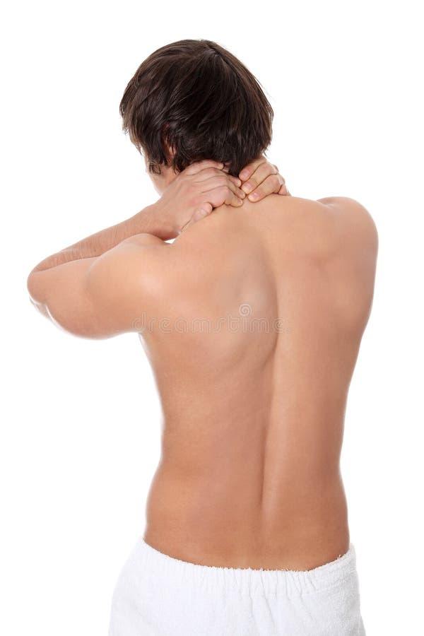 Hombre joven que levanta dolor de espalda. imagen de archivo libre de regalías