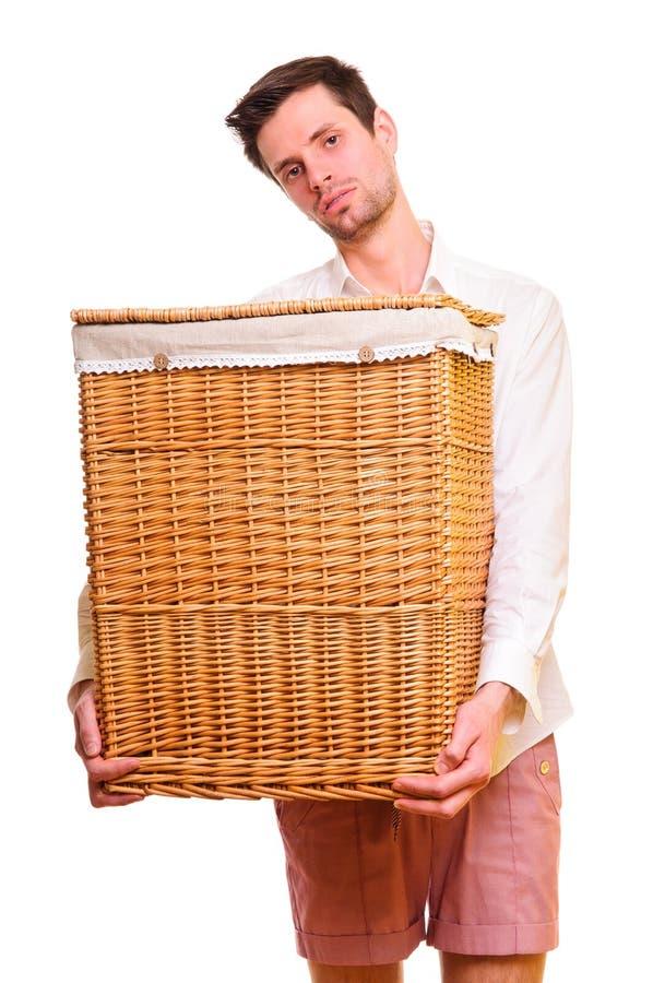 Hombre joven que lleva a cabo un flasket grande imágenes de archivo libres de regalías