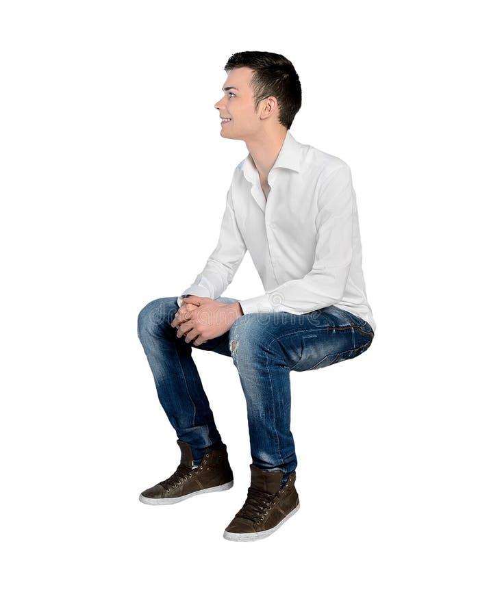 Hombre joven que mira el lado fotografía de archivo