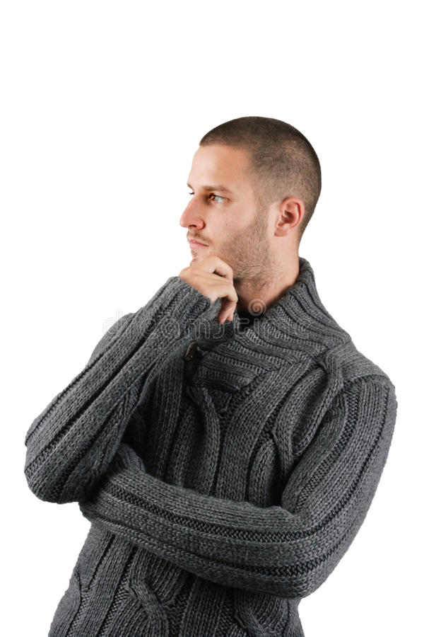 Hombre joven que piensa en algo fotografía de archivo libre de regalías