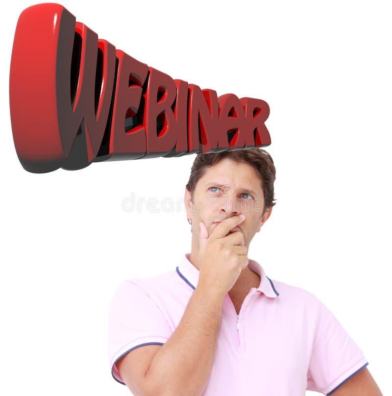 Hombre joven que piensa a un webinar fotos de archivo