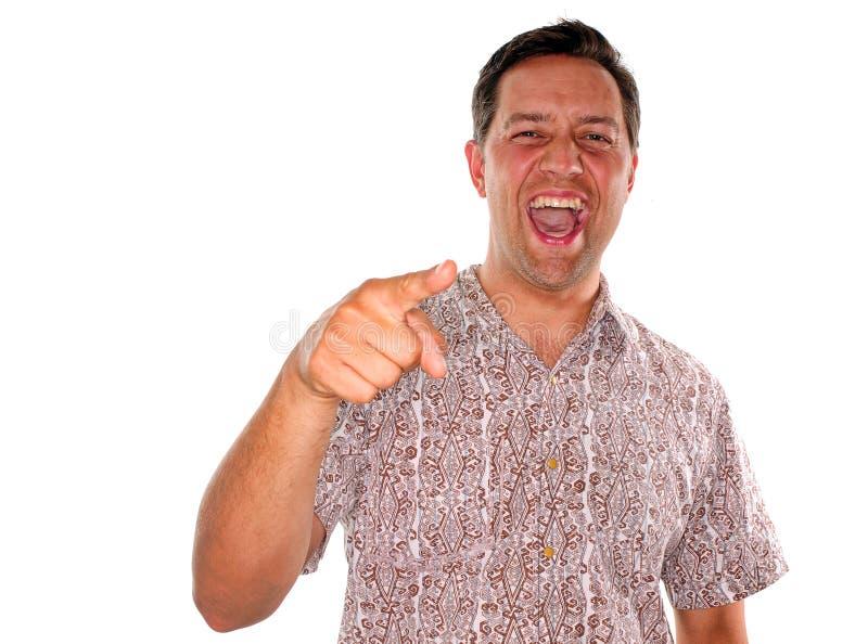 Hombre joven que ríe y que señala fotografía de archivo libre de regalías