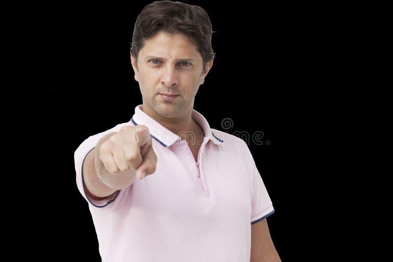Hombre joven que señala el finger a usted fotografía de archivo