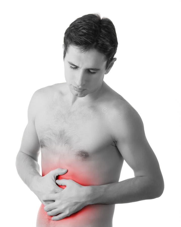 Hombre joven que se sostiene el estómago enfermo en dolor fotos de archivo