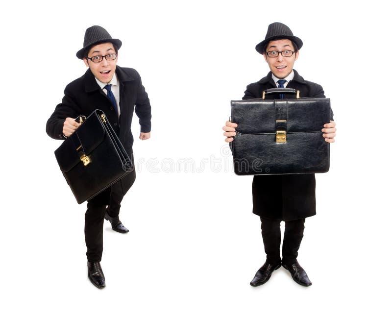 Hombre joven que sostiene la maleta aislada en blanco imágenes de archivo libres de regalías