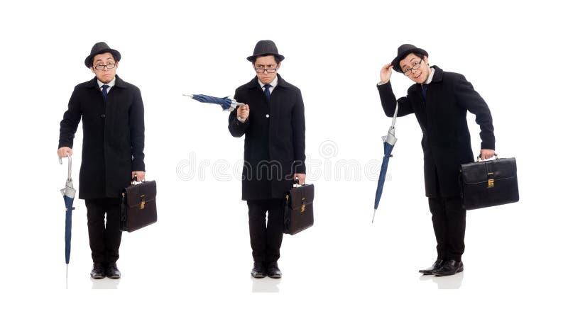 Hombre joven que sostiene la maleta y el paraguas aislados en blanco imágenes de archivo libres de regalías