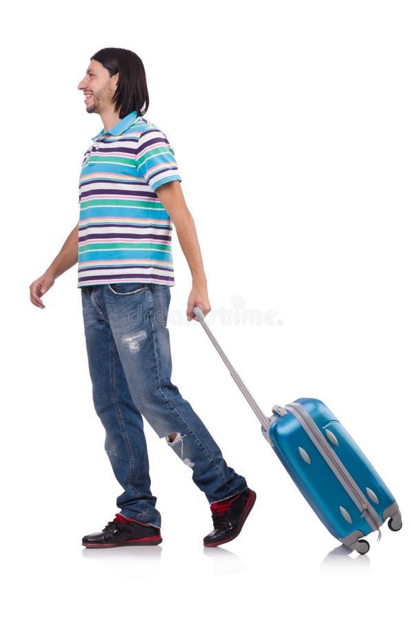 Hombre joven que viaja con las maletas aisladas fotos de archivo