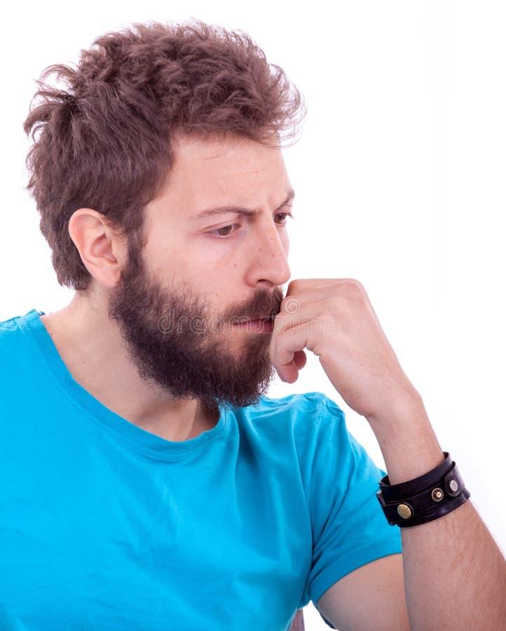 Hombre joven sonriente con la presentación de la barba imagenes de archivo