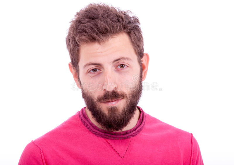 Hombre joven sonriente con la presentación de la barba imágenes de archivo libres de regalías