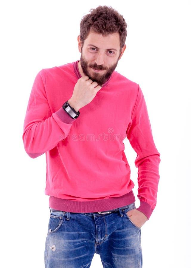 Hombre joven sonriente con la presentación de la barba foto de archivo libre de regalías