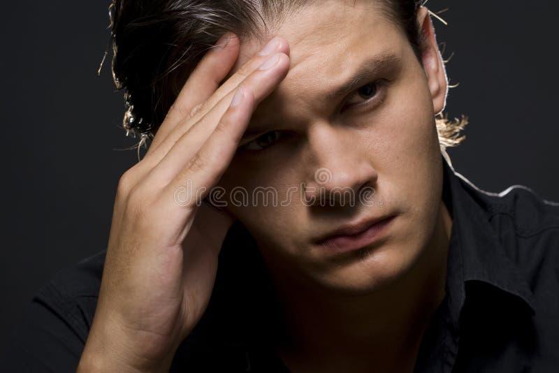 Hombre joven trastornado fotografía de archivo