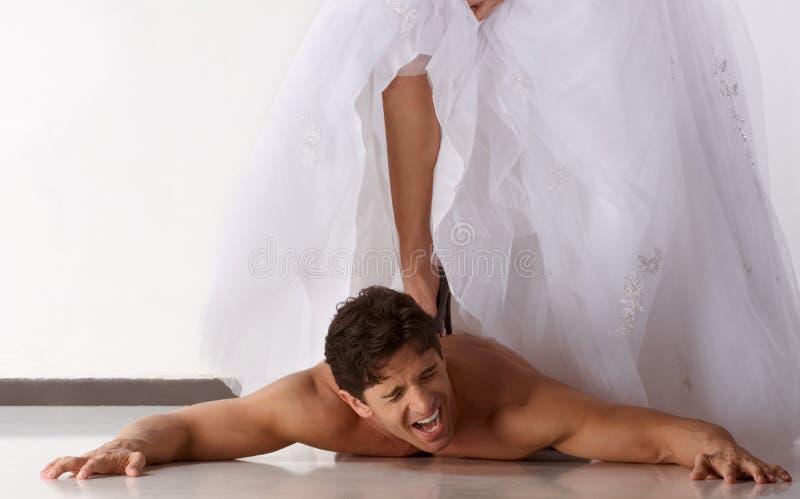 Hombre machacado tensionado por la unión dominada esposa fotografía de archivo libre de regalías
