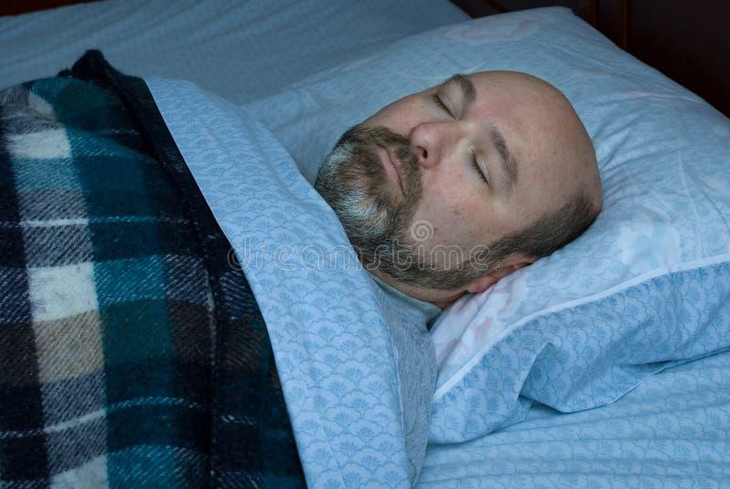 Hombre maduro durmiente fotografía de archivo
