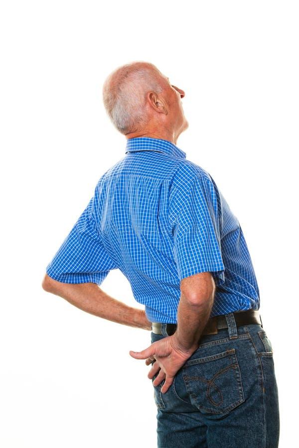 Hombre mayor con dolor de espalda fotografía de archivo