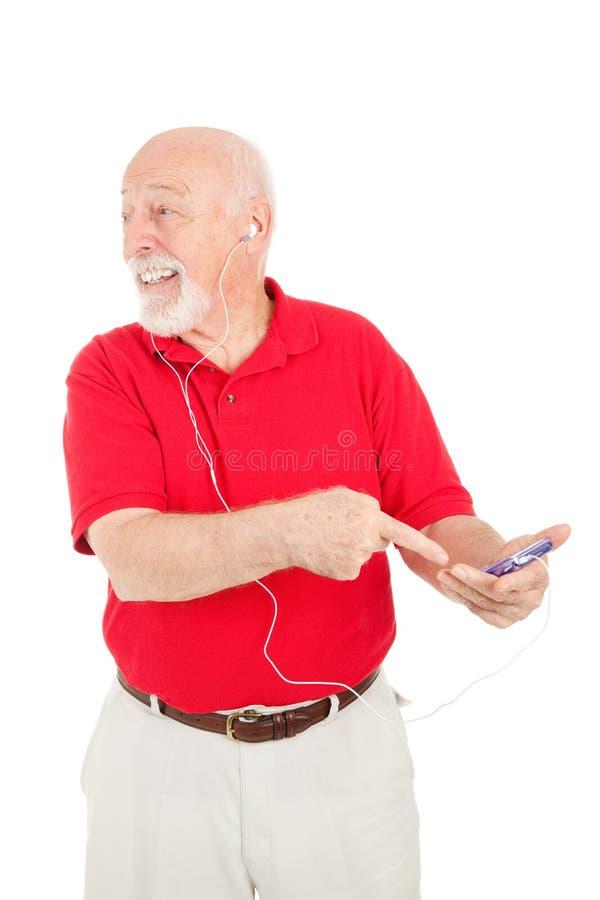 Hombre mayor emocionado sobre el jugador MP3 imagen de archivo