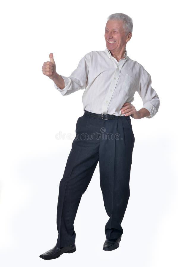 Hombre mayor que muestra el pulgar para arriba fotos de archivo