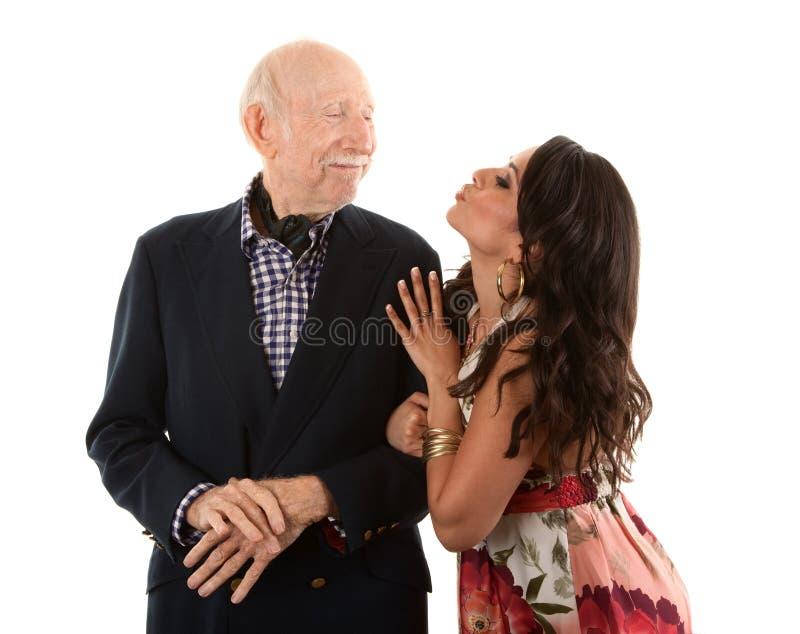 Hombre mayor rico con la esposa del oro-cavador imagen de archivo