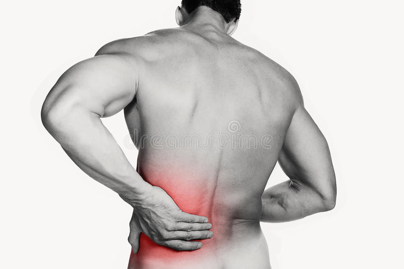 Hombre muscular con dolor de espalda fotografía de archivo libre de regalías