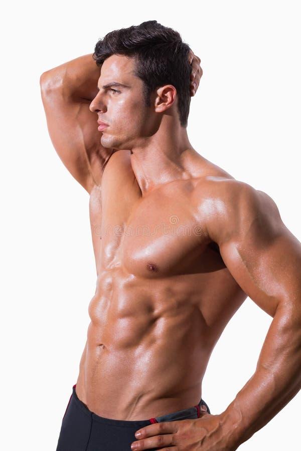 Hombre muscular descamisado joven foto de archivo