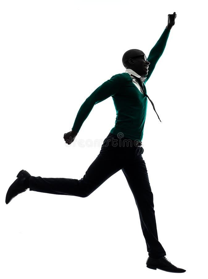 Hombre negro africano que corre la silueta feliz imagen de archivo libre de regalías