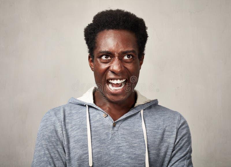 Hombre negro enojado fotos de archivo