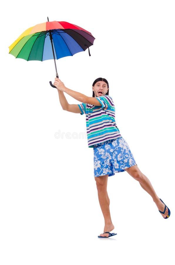 Hombre positivo con el paraguas colorido aislado encendido foto de archivo libre de regalías