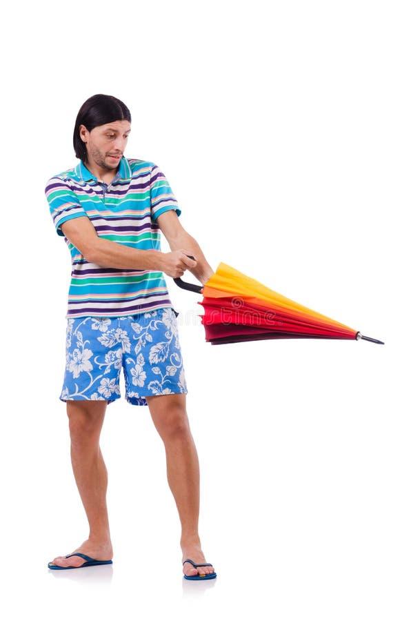 Hombre positivo con el paraguas colorido aislado encendido fotografía de archivo libre de regalías