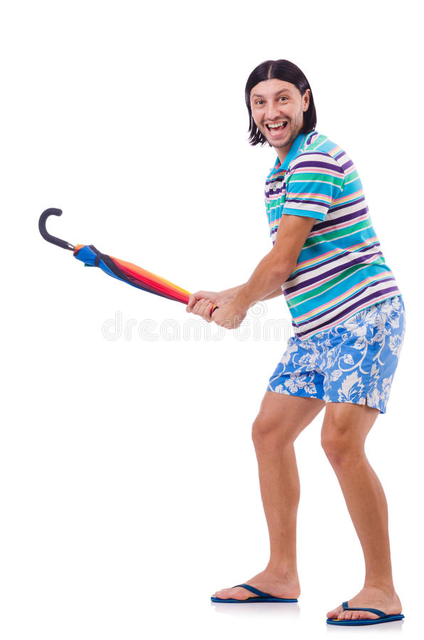 Hombre positivo con el paraguas colorido aislado encendido foto de archivo